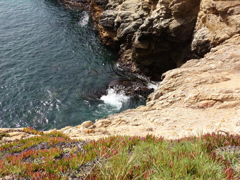 California Coastal Rocks and Cliffs, small inlet along the coast with vortex - Road Trip down Highway 1 stock images