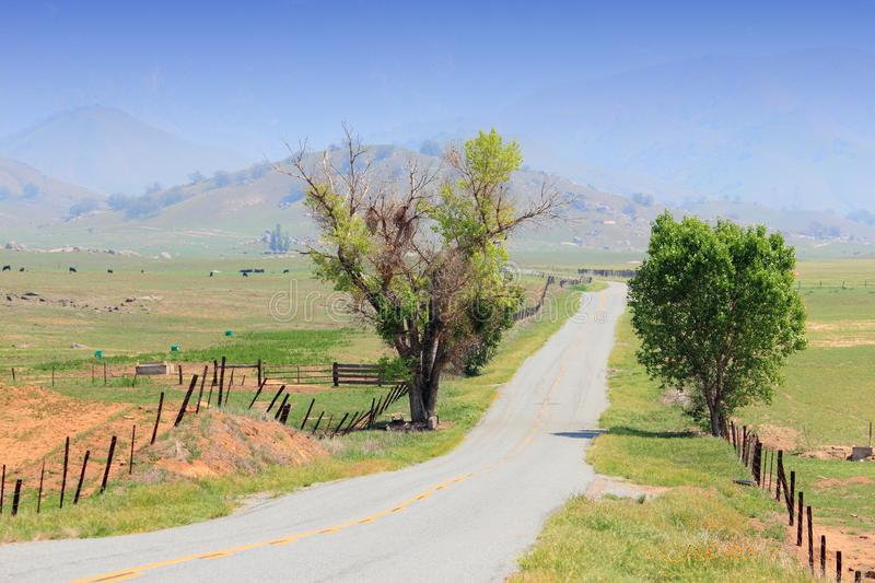 California countryside. California, United States - winding road in countryside landscape of Tulare County royalty free stock photo