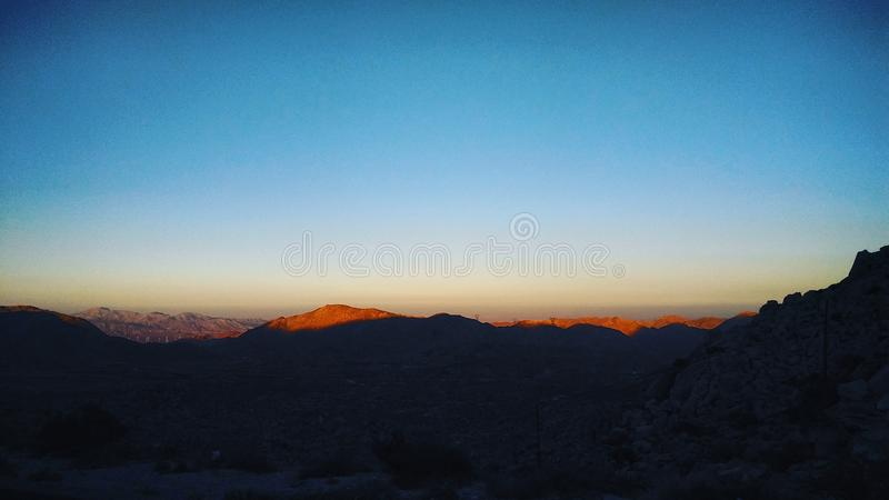 Sunset over the mountains. stock images