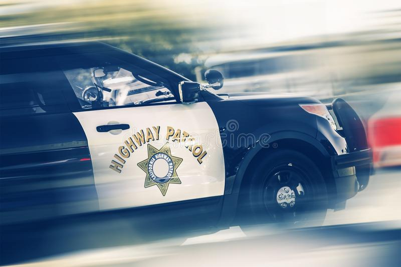 California Highway Police. In Motion. SUV Police Cruiser on a Highway royalty free stock photos