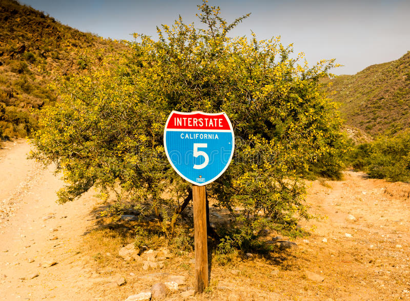 California interstate 5 traffic sign in front of desert thorn tr stock image