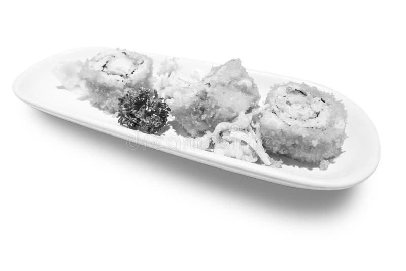 California Maki Sushi con Masago - rotolo fatto di polpa di granchio, avocado, cetriolo dentro Masago fuori fotografie stock