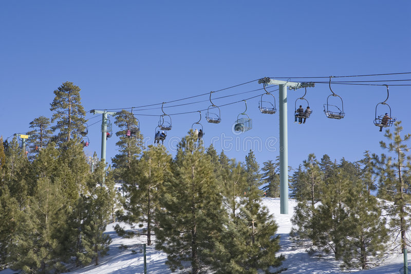 California Pine Trees and Ski Lift. California Ski lift with Pine Trees in the forground stock photography