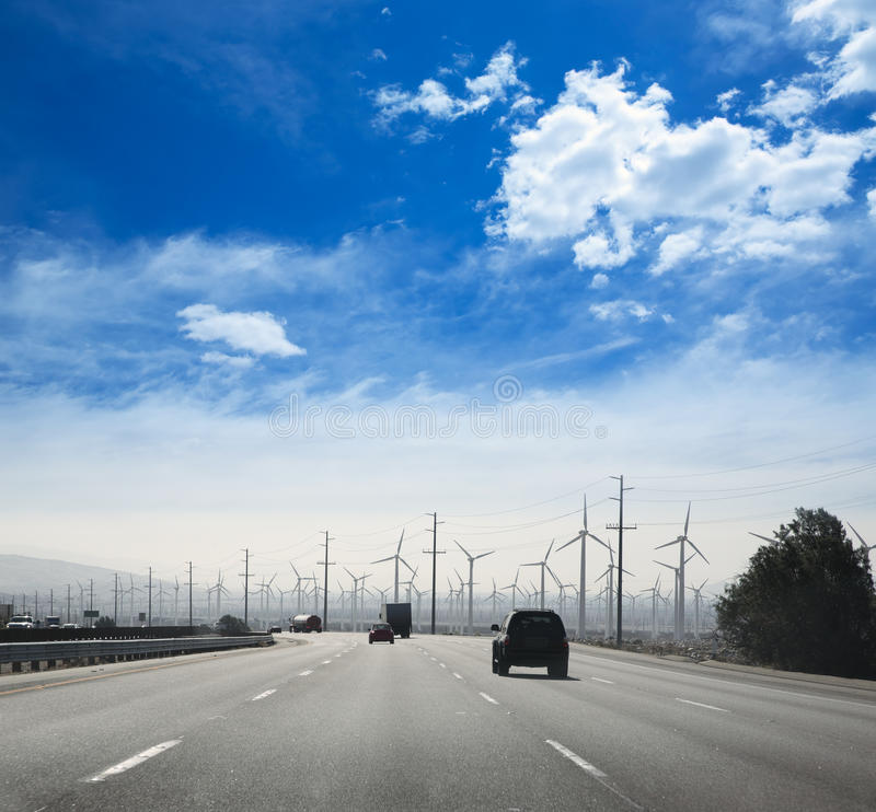 California road with electric windmills aerogenerators royalty free stock image