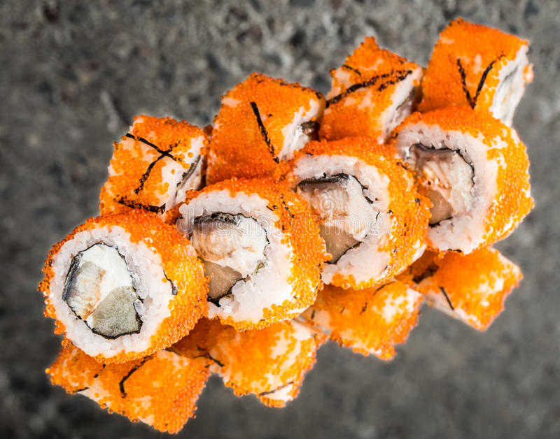 California roll made with tobiko, eel, cheese royalty free stock photos