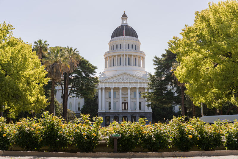 California State Capitol building in Sacramento. Backlit morning scene of the front of the California State Capitol building in the capital of Sacramento with stock photo
