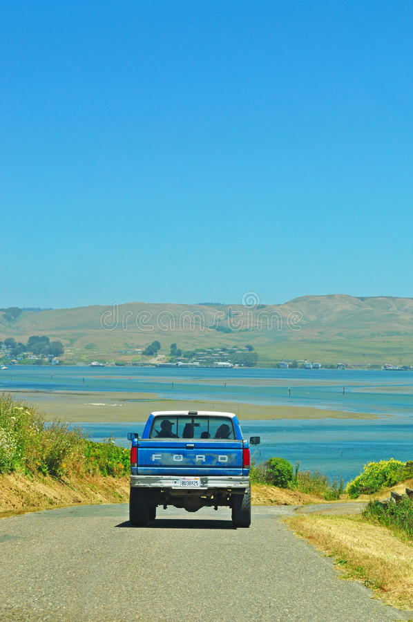 California, United States of America, Usa. A van and the view of the inlet of Bodega Bay on June 13, 2010. Bodega bay, in Sonoma County, is known for being the stock photography