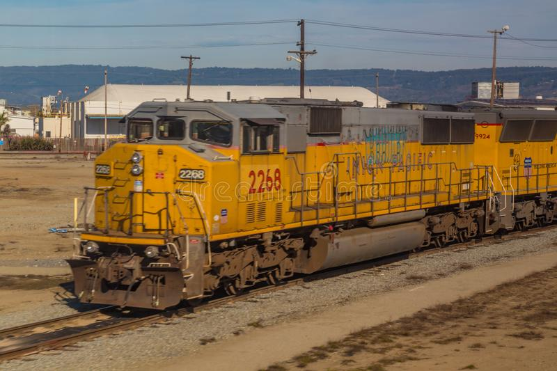 Yellow diesel locomotive freight train in sidings. stock photos