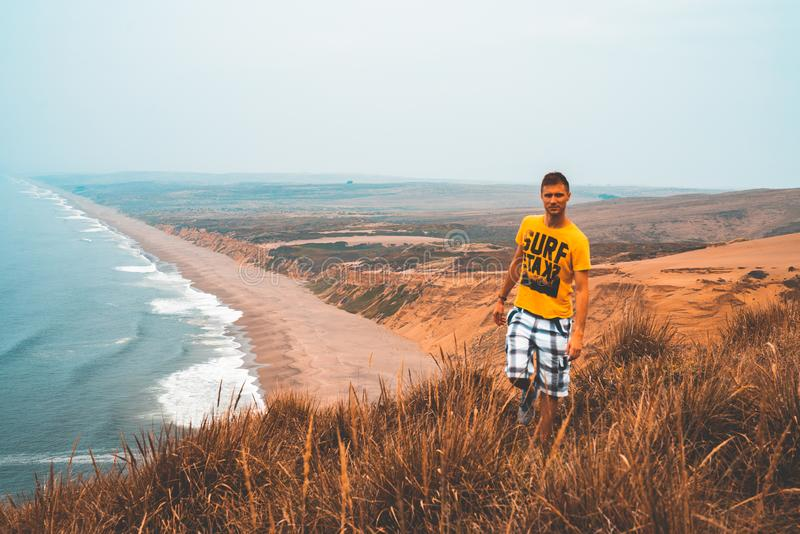 Young man exploring California by the ocean at Point Reyes cliffs. royalty free stock photos