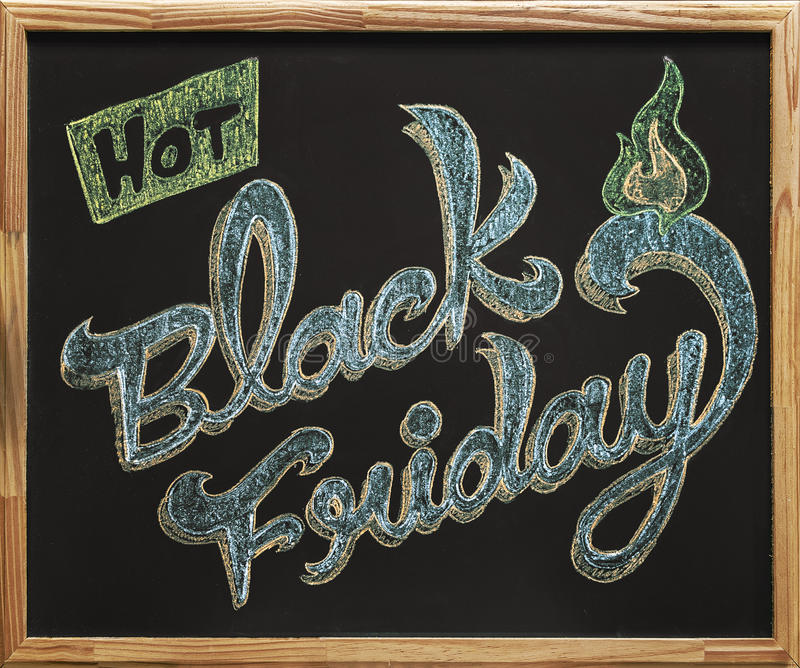 Caligrafia de Black Friday sobre o quadro-negro fotos de stock