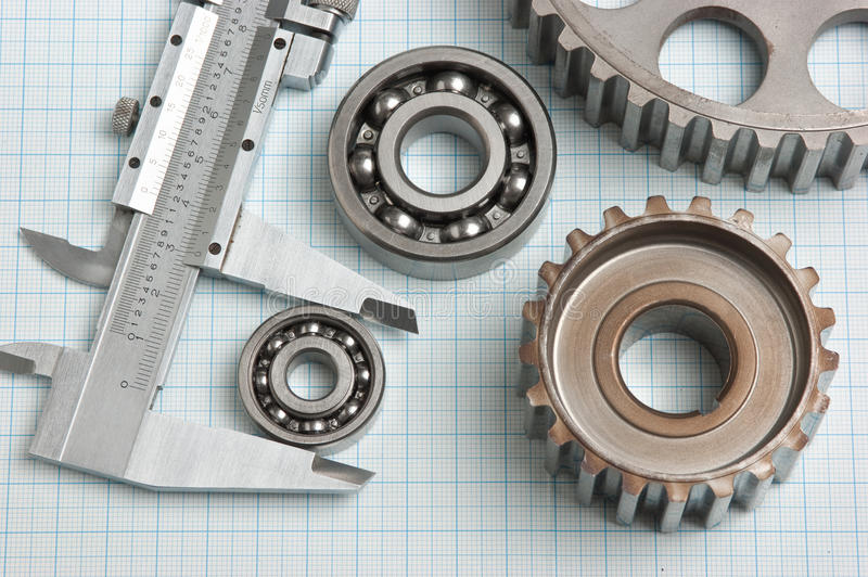 Caliper with gears and bearings. On graph paper royalty free stock images