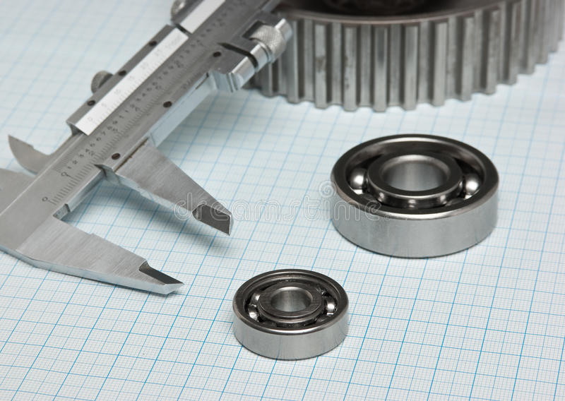 Caliper with gears and bearings. On graph paper stock images