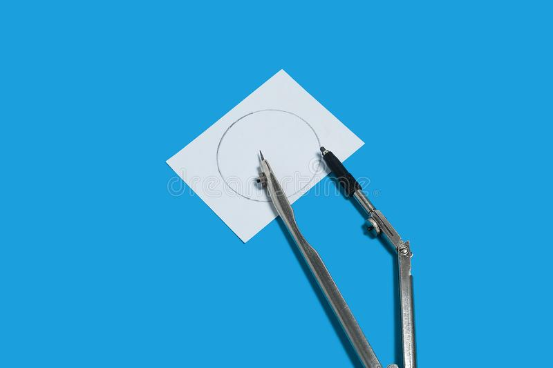 Calipers and a notation paper. Metal calipers and a memorandum white paper lying on a blue background. concept of office chancery. free space for advertising royalty free stock images