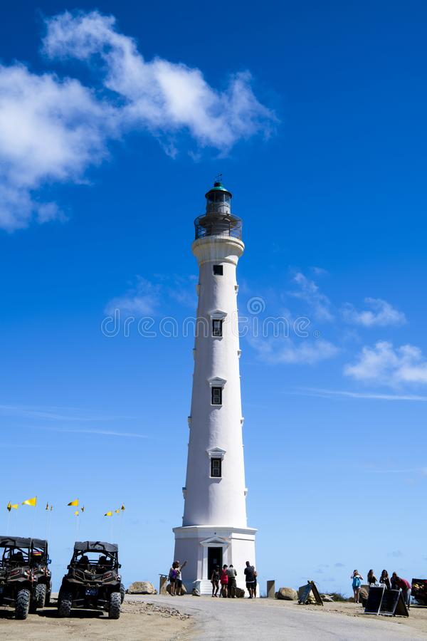 California Lighthouse with ATV cars, Quads, Aruba. Calirnia Lighthouse, a famous Landmark of Aruba, with Tourist an ATV cars, quads, four wheeler, fun vehicles stock photos