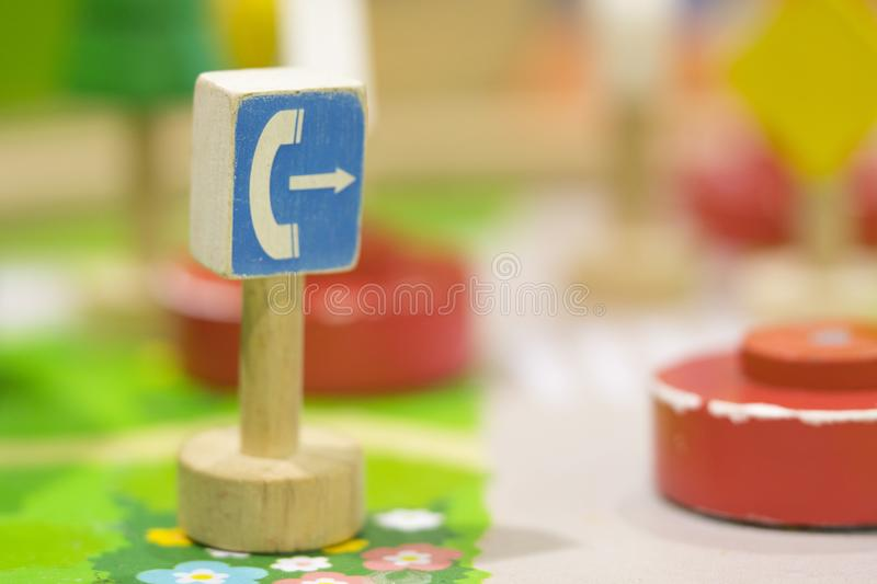 Call Box Sign Wooden toy - Play set Educational toys for preschool indoor playground (selective focus). Call Box Sign Wooden toy - Play set Educational toys for royalty free stock image