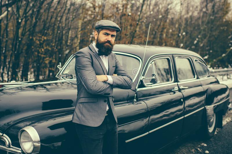 Call boy in vintage auto. Escort man or security guard. Retro collection car and auto repair by mechanic driver. Bearded stock images