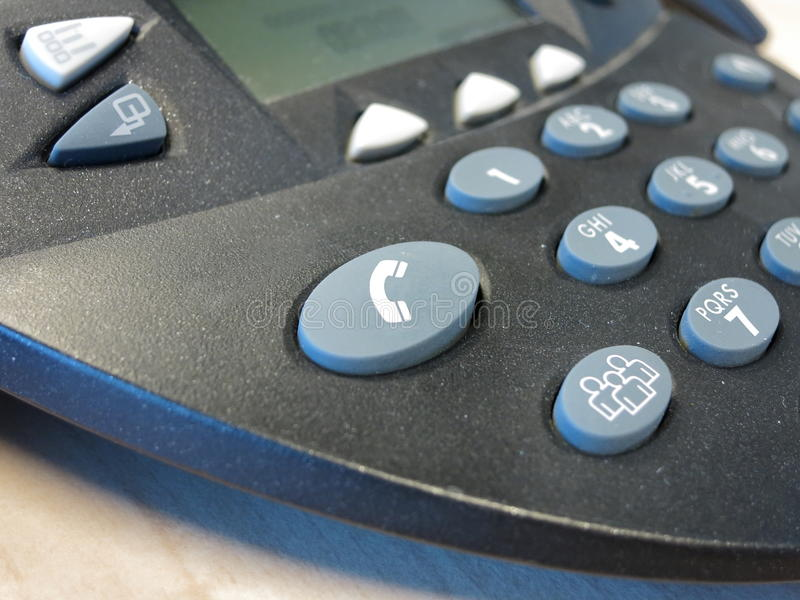 Call-button on conference telephone stock images