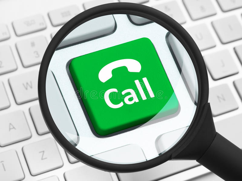 Call button under the magnifying glass. Computer key with call button under the magnifying glass stock photos