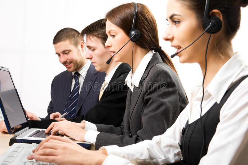 Call center. Attractive young people working in a call center