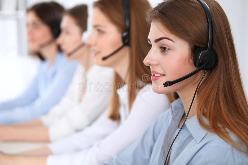 Call center. Beautiful cheerful smiling operator consulting clients with headset. Business concept of customer service stock photos