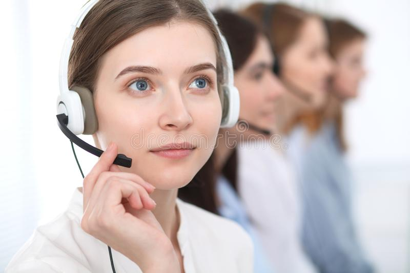 Call center. Beautiful cheerful smiling operator consulting clients with headset. Business concept of customer service stock image