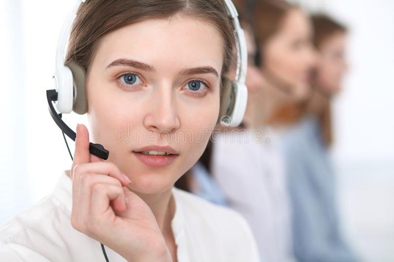 Call center. Beautiful cheerful smiling operator consulting clients with headset. Business concept of customer service stock images