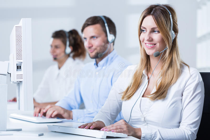 Call center consulatnt during work stock photography