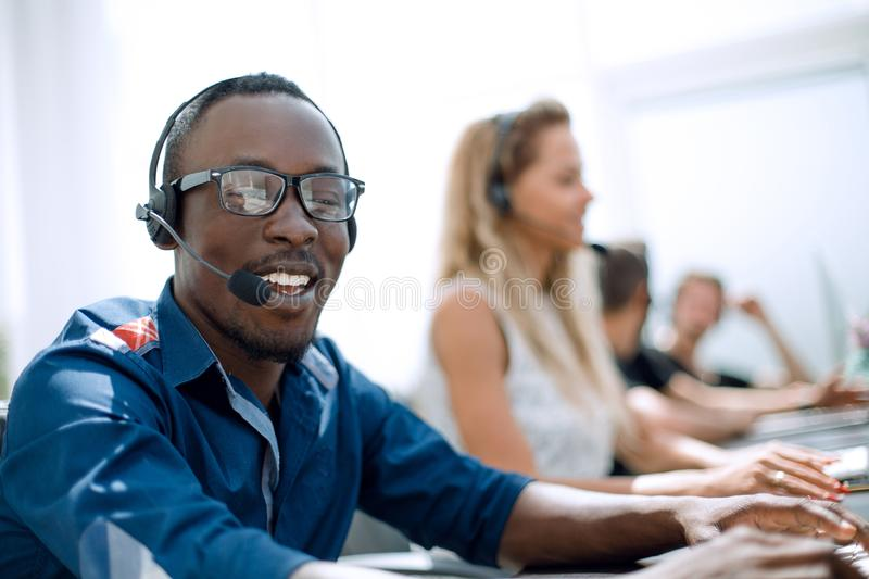 Call center employee on the background of colleagues stock images