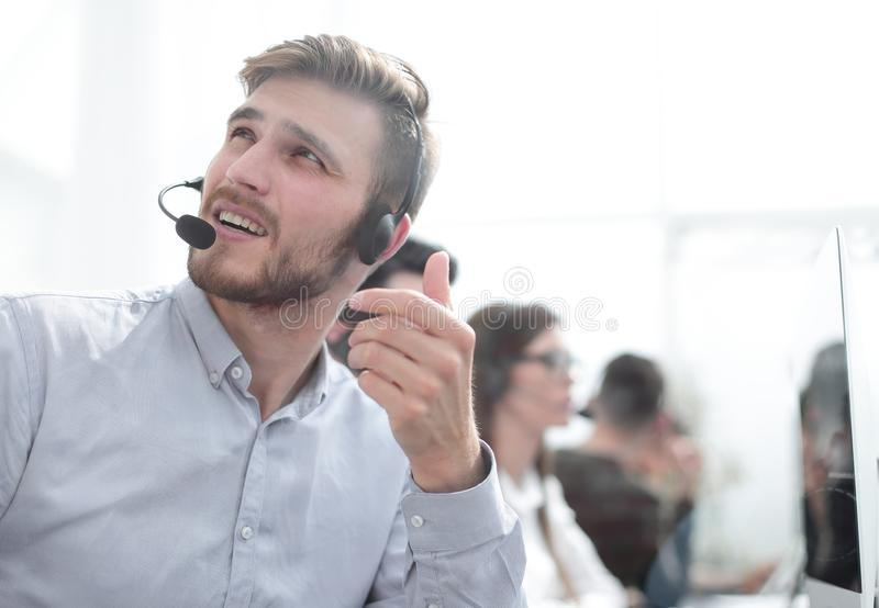 Call center employee talking with a colleague in the office stock images
