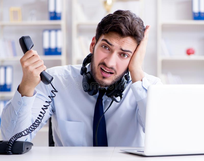 Call center employee working in office. The call center employee working in office royalty free stock image