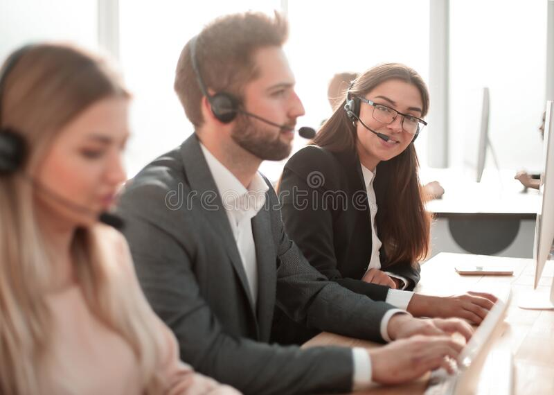 Call center employees work with clients in a modern office royalty free stock photography