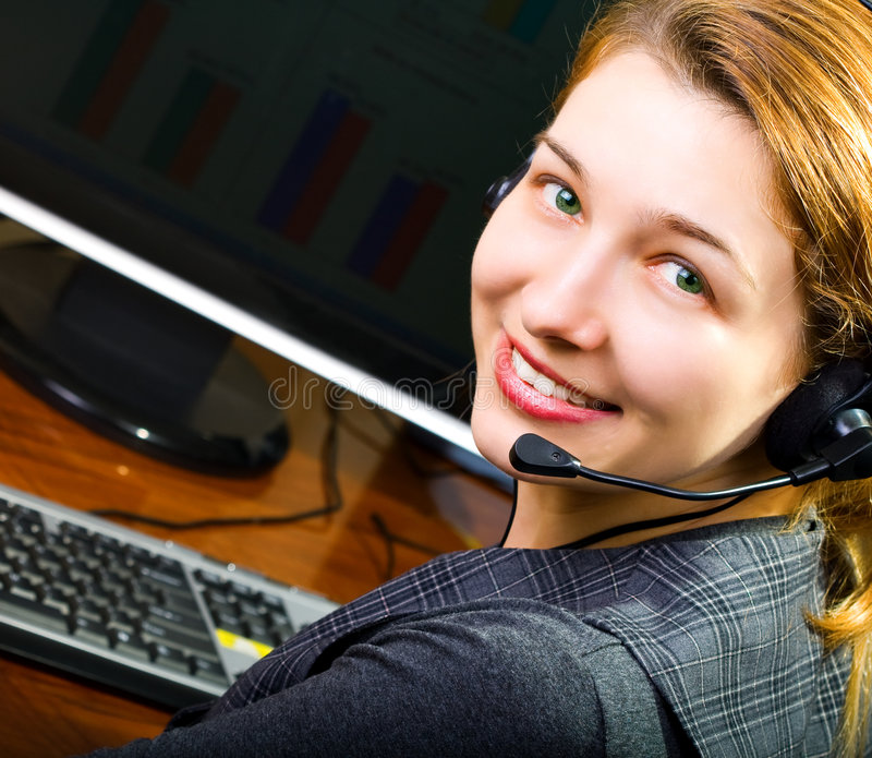 Call center female operator smiling royalty free stock photo