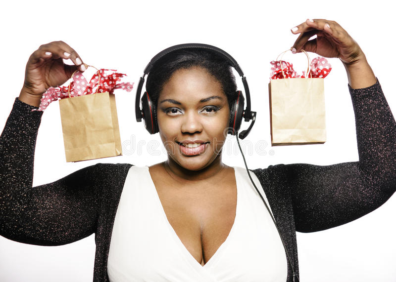 Call center girl. With shopping bags stock photography