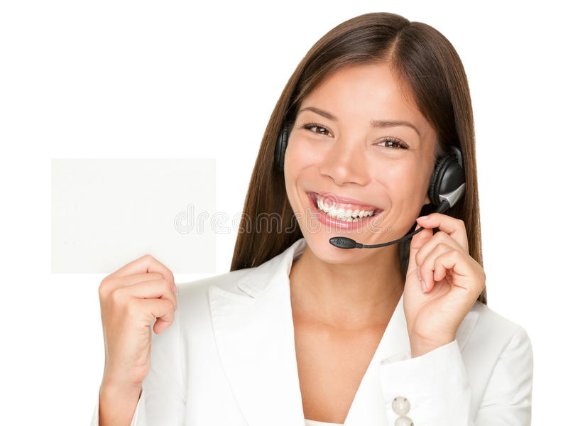 Call center headset woman sign. Headset. Customer service operator woman from call center smiling with headset showing blank empty sign card for copy space royalty free stock image