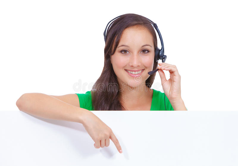 Call center headset woman sign. Headset customer service woman showing blank billboard sign isolated on white background stock photos