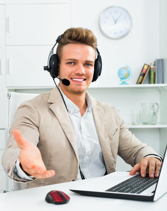 Call center male operator talking with client stock photography