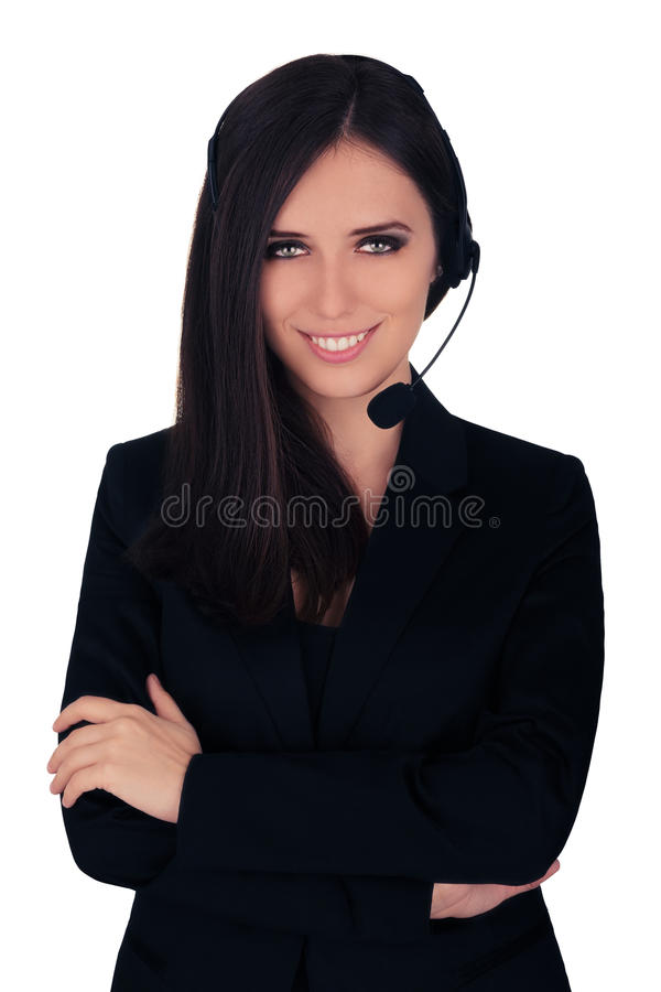Call Center Operator in Black Blazer. Beautiful young woman call center operator with headset and black blazer smiling royalty free stock photography