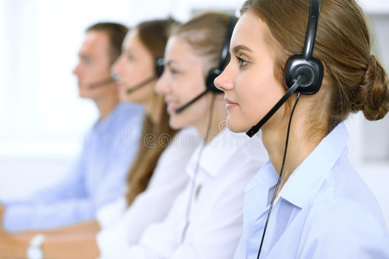 Call center operator in headset while consulting client. Telemarketing or phone sales.  royalty free stock photo