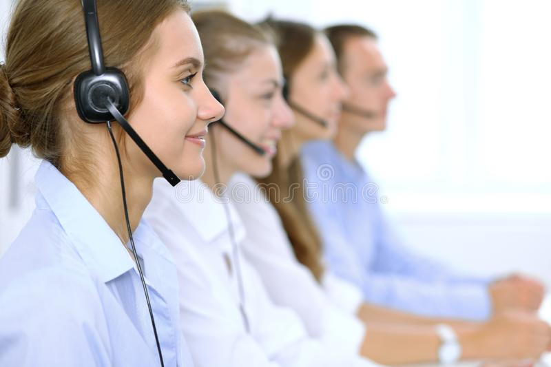 Call center operator in headset while consulting client. Telemarketing or phone sales.  royalty free stock photos