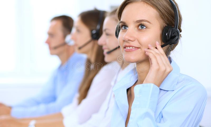 Call center operator in headset while consulting client. Telemarketing or phone sales.  stock images