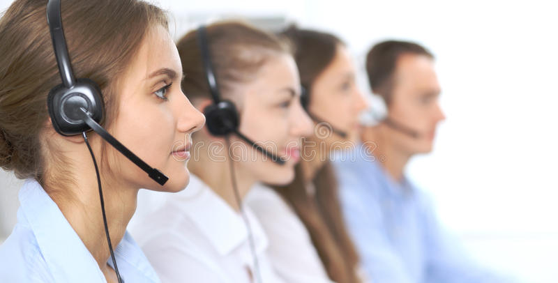 Call center operator in headset while consulting client. Telemarketing or phone sales. Customer service and business. Concept royalty free stock images