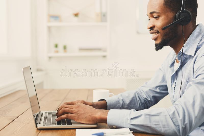 Call center operator man with headset working stock images