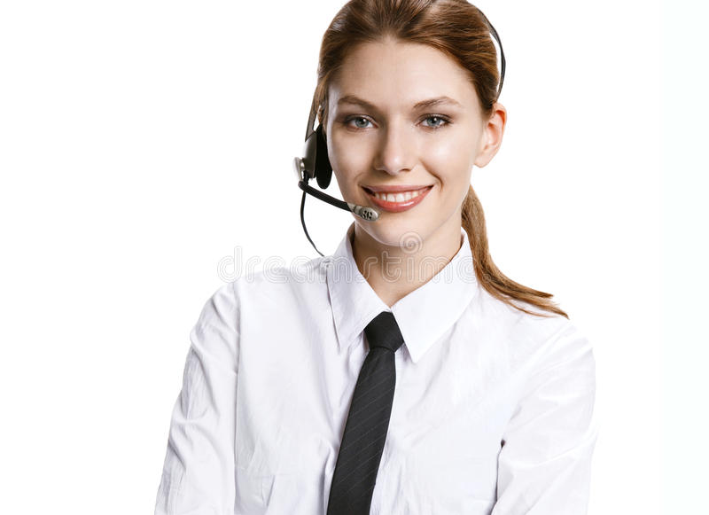 Call center operator. Portrait of young smiling girl with hands free - isolated on white background royalty free stock image