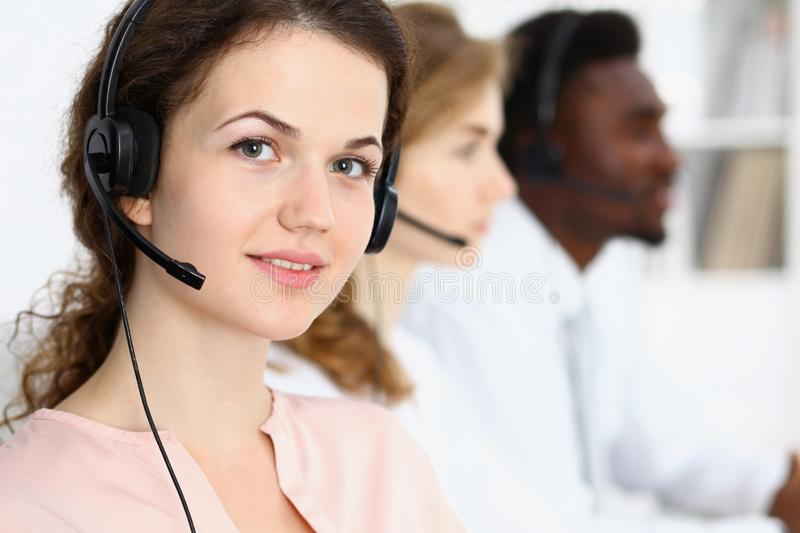 Call center operator.Young beautiful brunette woman in headset. Business concept royalty free stock photos