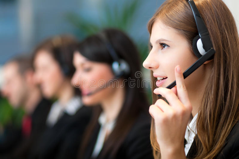 Call center operators at work royalty free stock image