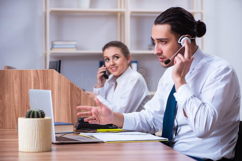 Call center operators working in the office royalty free stock photo