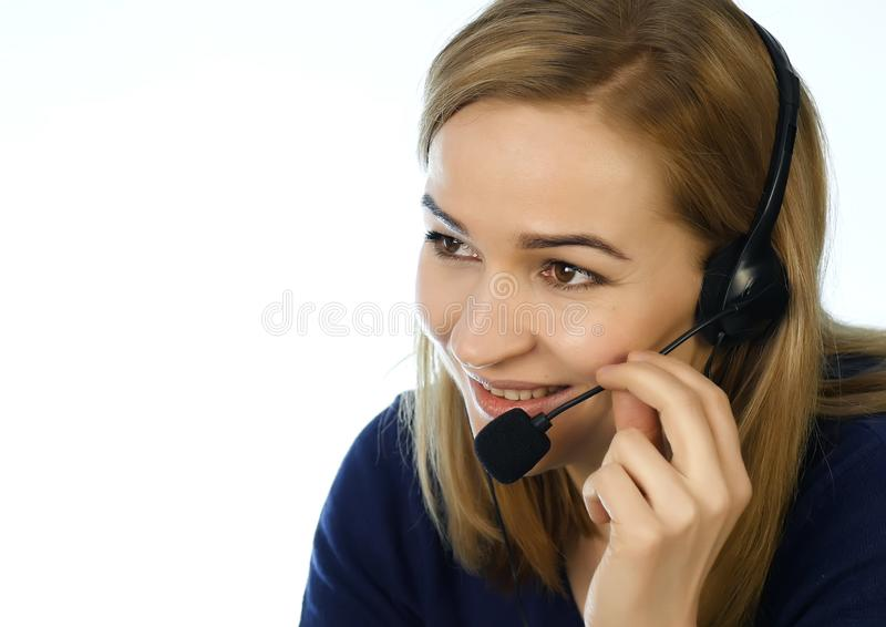 Call center representative talking on helpline, Headset telemarketing positive female call center agent at work. Call center representative talking on helpline stock photography