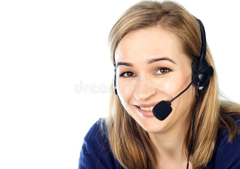 Call center representative talking on helpline, Headset telemarketing positive female call center agent at work. Call center representative talking on helpline royalty free stock photo
