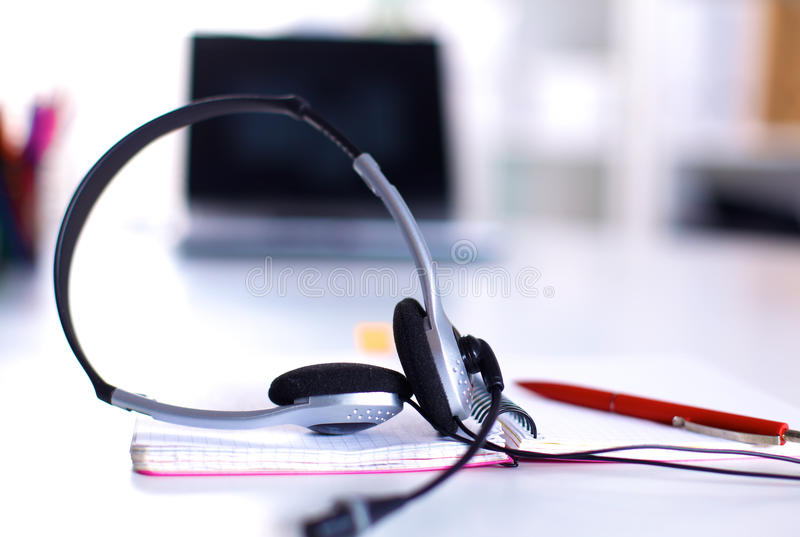 Call center service operator empty working place. Headset, glasses, keyboard and monitor at helpdesk employee workplace. Effective and efficient business royalty free stock image