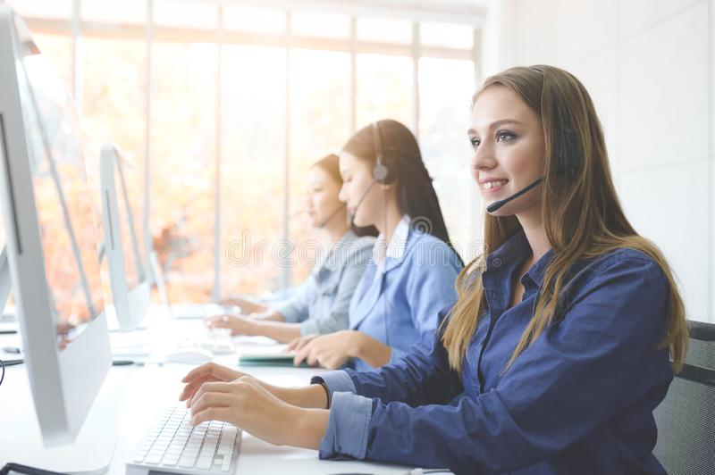 Help line answering and telemarketing. Call Center Service. Photo of customer support or sales agent.  Help line answering and telemarketing. Female caller or stock photography